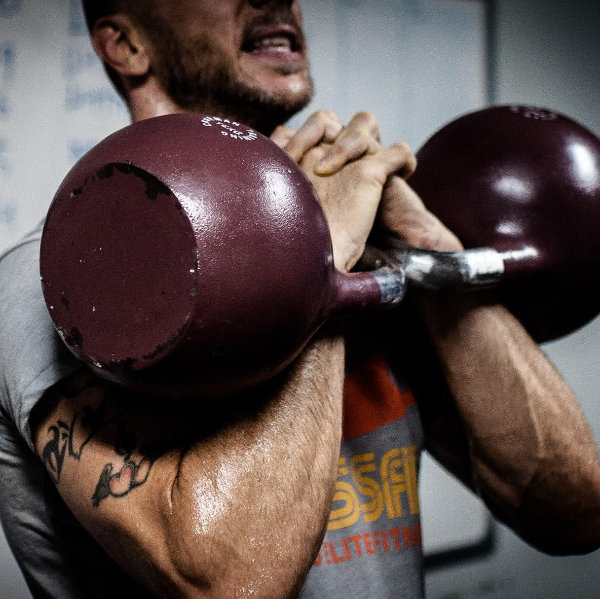 A man lifting kettlebells
