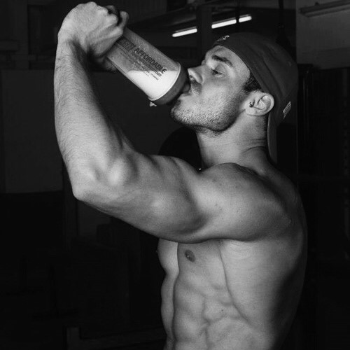 A man drinking protein