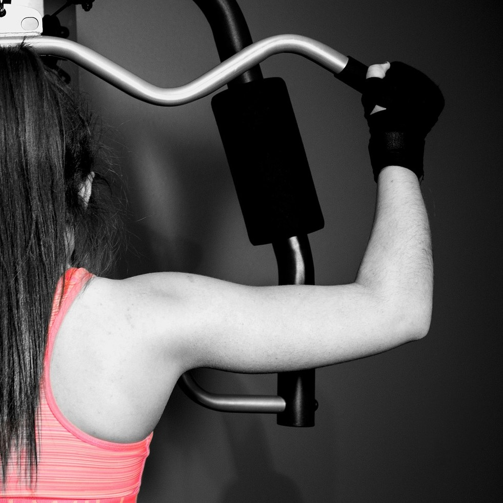 A girl doing pull downs