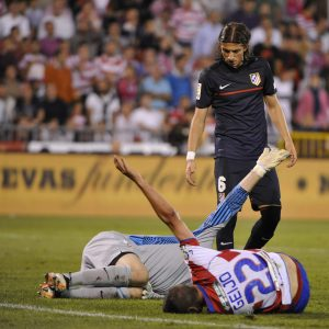 Two men laying down from an injury