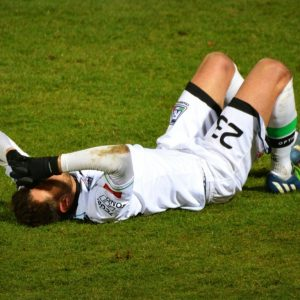 Injury football player laying down
