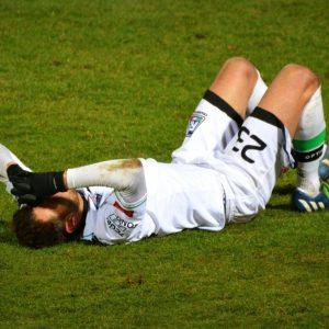 Injury football player laying down